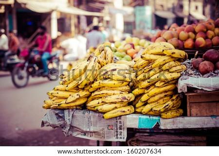 Banana hanging in asian market, closeup  - stock photo