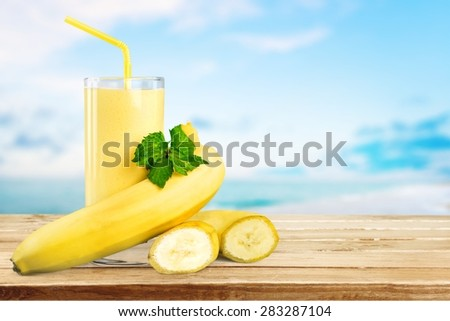 Banana, milk, slice. - stock photo