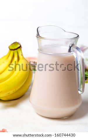 Banana milk smoothie with drinking straws. Isolated on white background