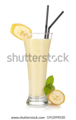 Banana milk smoothie with mint and drinking straws. Isolated on white background - stock photo