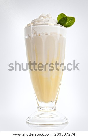 Banana milkshake in a tall glass with fresh mint - stock photo