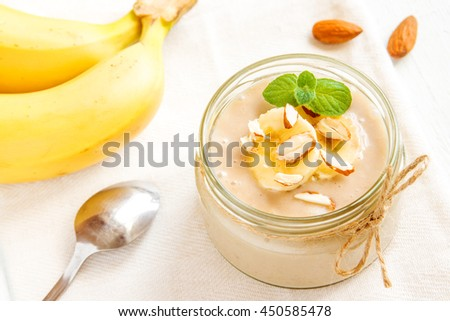 Banana mousse with almond and mint for healthy vegetarian dessert  - stock photo