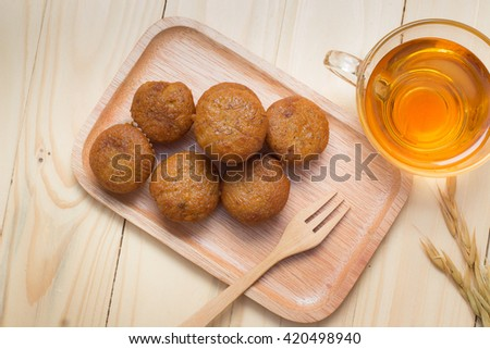 Banana muffin cake and tea on wood background - stock photo