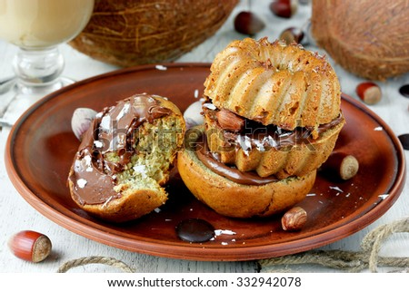 Banana Muffins with nuts, coconut and chocolate - stock photo