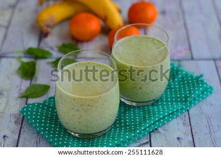 Banana Orange Spinach Smoothie - stock photo