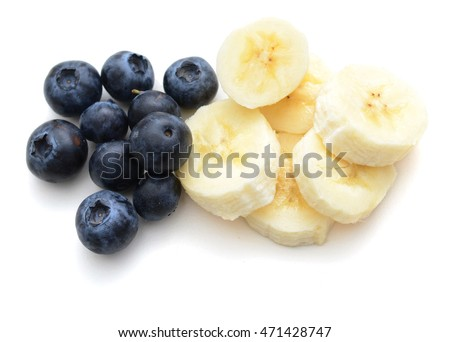 Banana slices with blueberry isolated on white