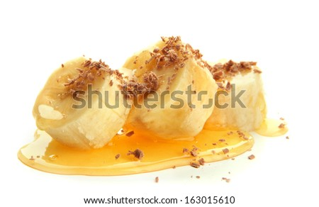 Banana slices with honey, isolated on white - stock photo