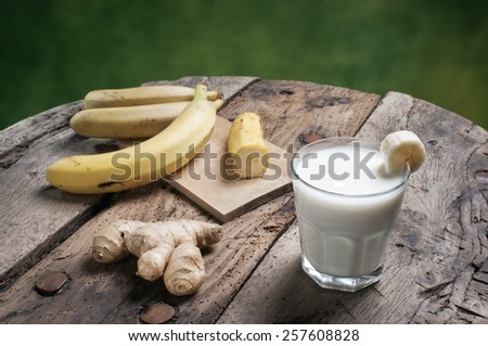 Banana Smoothie on a wooden table - stock photo