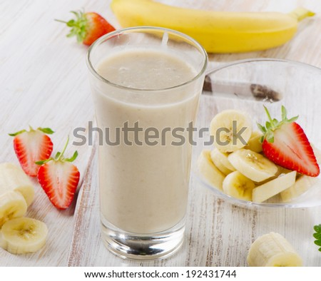 Banana Smoothie with fresh berries. Selective focus