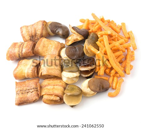 Banana snack,broad beans and bread sticks on white background - stock photo