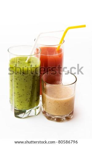 banana, strawberry and kiwi fresh juice in glasses isolated on white background - stock photo