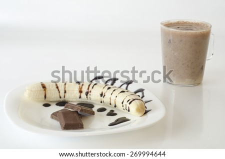 Banana with chocolate and milkshake isolated on white background - stock photo