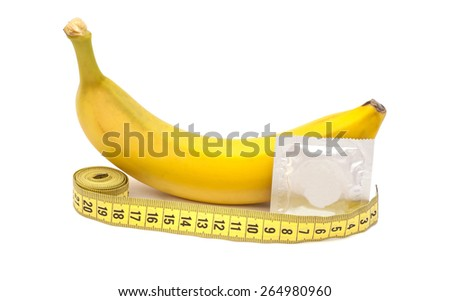 Banana with Condom and measuring tape isolated on white  - stock photo
