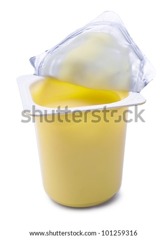 Banana yoghurt in open plastic cup isolated on white