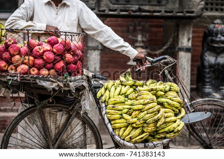 bananas and apples on a bike on a street market