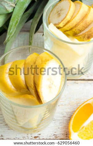 Bananas and pineapples in a glass