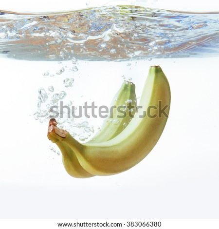 bananas fell into the water, isolated on white - stock photo