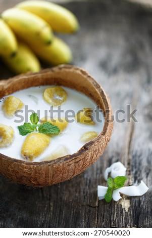 Bananas in coconut milk, pal�©o and vegan dessert. - stock photo