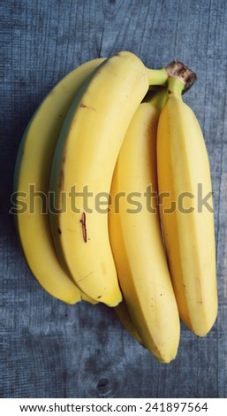 bananas on a wooden background - stock photo