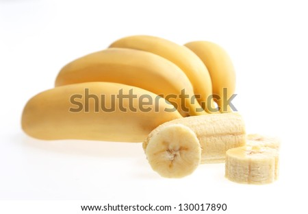 Bananas with peeled and chopped one isolated on white Fruit - stock photo
