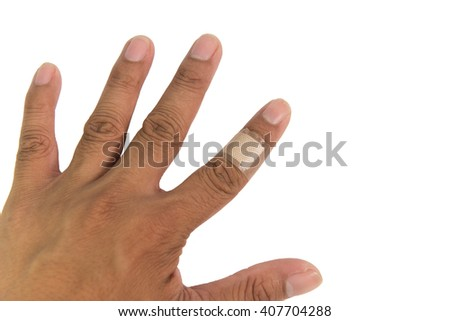 Band aid plaster applied to a female finger  isolated on a white background