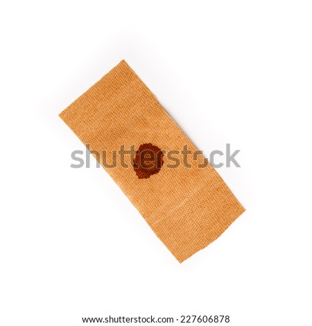 Band aid with dried blood isolated on a white background. Wound, cure, care, help, relief. - stock photo