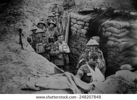 Bandaged British World War 1 soldiers in a battlefield trench, 1915-1918. - stock photo