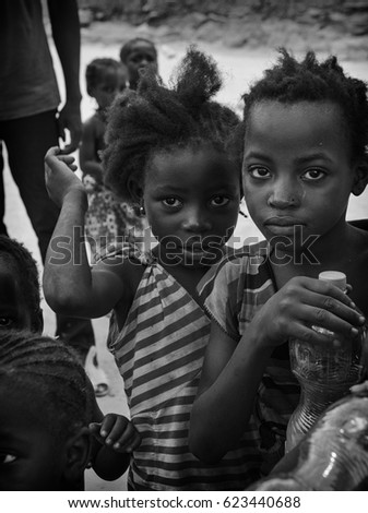 BANDIAGARA, MALI - 05 July 2015: An image black african children standing outside with happy face