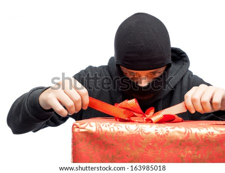 bandit holding a wrapped Christmas gift - stock photo