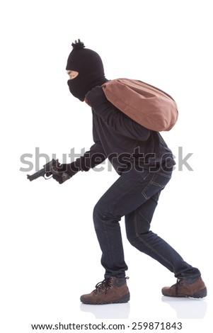 Bandit holding gun with bag on over white background