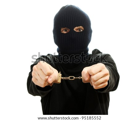 Bandit in black mask handcuffed isolated on white