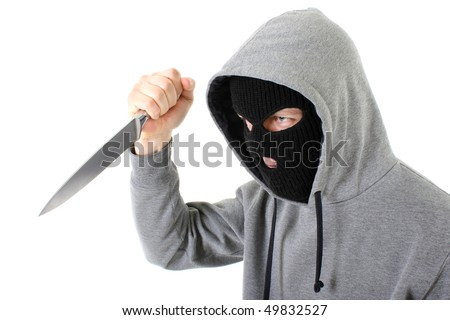 Bandit in black mask with knife - stock photo