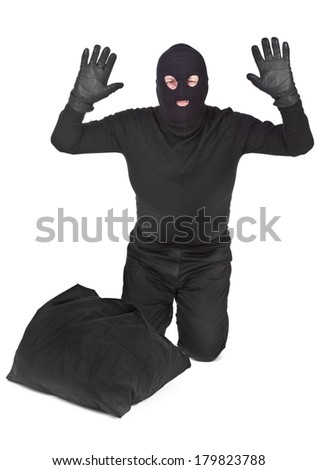 bandit with sack surrendering  over white background - stock photo