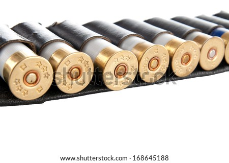 Bandolier with hunting ammunition. Isolated on a black background. - stock photo