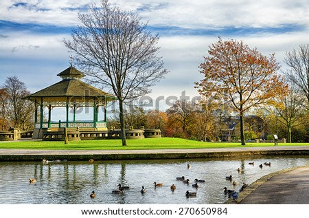 Bandstand and duck pond in Greenhead park, Huddersfield, Yorkshire, England - stock photo