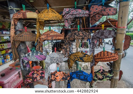 BANDUNG, INDONESIA - JANUARY 22 2016: A small shop selling Indonesia traditional silat cap and necklace around Cihampelas Walk in Bandung, Indonesia.