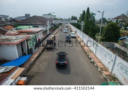 BANDUNG, INDONESIA - JANUARY 15 2016: View from a bridge of a road lane to Bandung railway station with a signboard 'Welcome to Bandung Station' in Indonesia at Bandung, Indoensia.