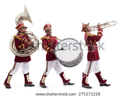 Bandwalas with instruments marching - stock photo