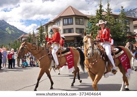 Banff, Alberta, Canada - July 1, 2012: Calgary Stampede Princesses wave at spectators at the Canada Day Parade in Banff, Alberta, on July 1st, 2012 in Banff.  - stock photo