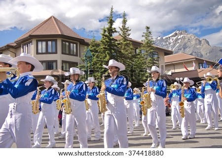 Banff, Alberta, Canada  July 1, 2012: Canada Day Parade in Banff, Alberta, on July 1st, 2012. Canada Day is celebrated with barbecues, parades, music, and evening fireworks. - stock photo