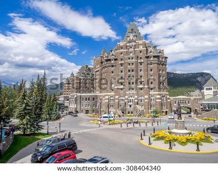 BANFF, CANADA - AUG 9, 2015: The Banff Springs Hotel on August 9, 2015 in the Canadian Rockies. The Banff Springs Hotel was built during the 19th century in Scottish Baronial style. - stock photo