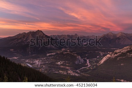 Banff in Alberta, Canada with mountain range  in the background at sunset time - stock photo