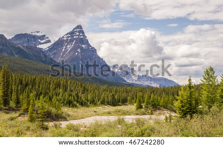 Banff national park with chairs and cloudy mountains and forest in Canada.