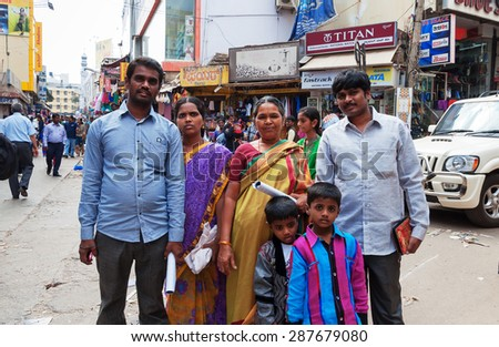 BANGALORE, INDIA - DEC 25, 2014: Unidentified Indian family on Russell Market. Russell Market is a shopping market in Bangalore, built in 1927 by the British.