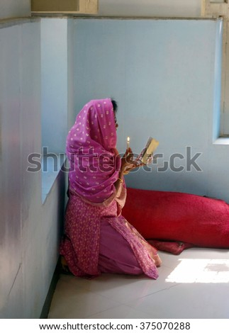 BANGALORE, INDIA - MARCH 22, 2011: Unknown woman praying in St. Patrick's Church, Bangalore, India.