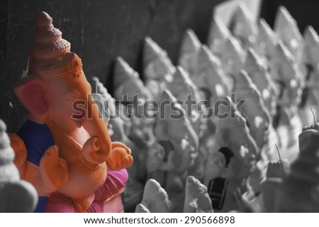 Bangalore, Karnataka, India - Aug 27, 2013: One Painted clay Ganesha idol stands out among the bunch, at the onset of Ganesha festival