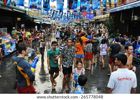BANGKOK - APR 13: Revellers celebrate the traditional Thai New Year or Songkran on Khao San Road on Apr 13, 2014 in Bangkok, Thailand. The new year is marked with water fights and street parties.