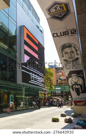 BANGKOK - APR 21 2014: Shoppers visit the newly renovated Siam Center mall  in Bangkok, Thailand. The mall re-opened in January 2013 and now houses 400 stores of leading fashion and clothing. - stock photo