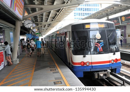 BANGKOK - APRIL 12: A BTS Skytrain departs from a station in the city centre on  April 12, 2013 in Bangkok, Thailand. Each train of the mass transport rail network can carry over 1,000 passengers.