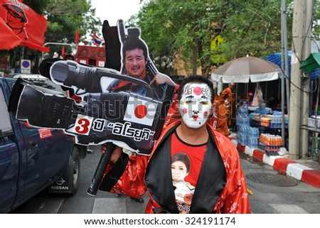 BANGKOK - APRIL 10: An activist leads a Red Shirt rally to the location where journalist Hiro Muramoto was killed during protests three years ago to the day on April 10, 2013 in Bangkok, Thailand. - stock photo